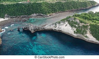 Aerial view of the green tropical coast of the island of...