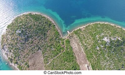 Aerial view of the heart shaped Galesnjak island on the adriatic coast