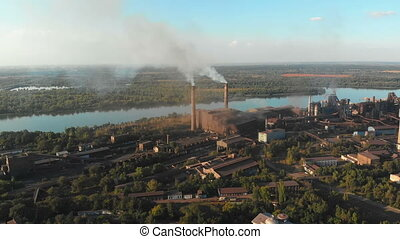 Aerial view of the Industrial Plant with Smoking Pipes near...