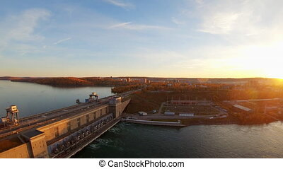 Aerial view of the Irkutsk hydroelectric power station. Dam on Angara river from bird's eye view. Panning, pan