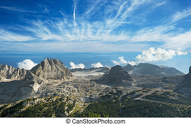 aerial view of the italian dolomites under a blue sky