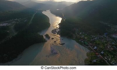 Aerial view of the Katun River and hills during sunset after...