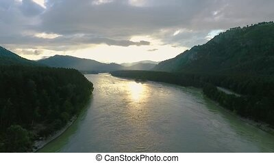 Aerial view of the Katun River and hills during sunset after rain. The Republic of Altai, Russia