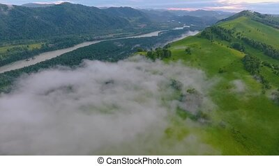 Aerial view of the Katun River and hills during the fog...