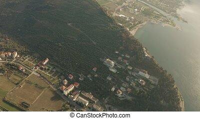 Aerial view of the Lake Garda mountainous coast near town of...