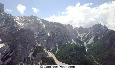 Aerial view of the large stone mountains in the Alps