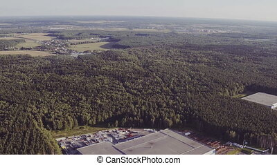Aerial view of the logistics warehouse in forest