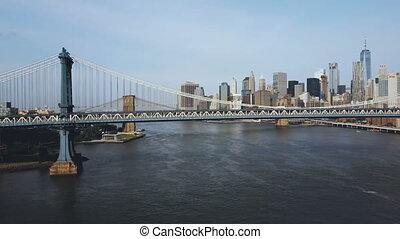 Aerial view of the Manhattan bridge through the East river....