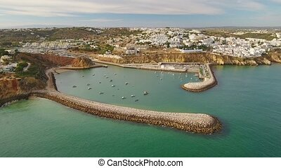 Aerial. View of the marina of Albufeira and breakwaters port, from the sky.