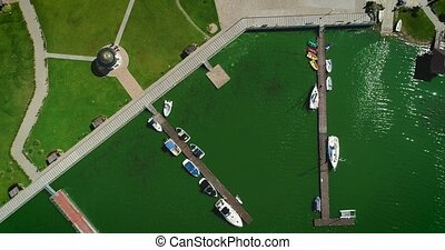 Aerial view of the Marina with white yachts in green water