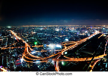 Aerial view of the motorway in central Bangkok at night, Thailand