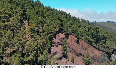 Aerial view of the mountain, arising from volcanic lava, cut...