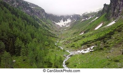 Aerial view of the mountain stream in the Alpine mountains....