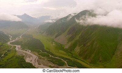 Aerial view of the mountains and canyon with mountain river.