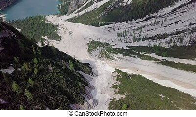Aerial view of the mudflow with snow high in the Alpine...