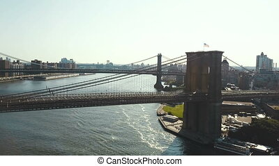 Aerial view of the New York, America. Drone flying over the Brooklyn bridge to Manhattan bridge through the East river.