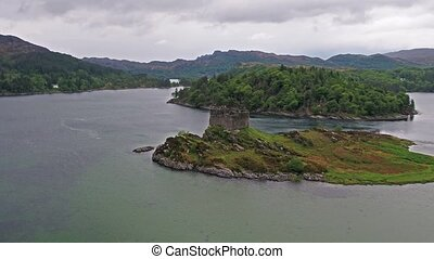 Aerial view of the old ruined Castle in the Highlands of...