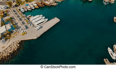 Aerial View of the Old Sea Port Where Many Ships, Boats and Yachts Stay, Tourists Walk Around. Sunny Day, Shot in 4K UHD