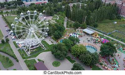 Aerial view of the park. Ferris wheel is in the Park. The ...