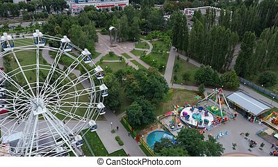 Aerial view of the park. Ferris wheel is in the Park. The Park is a landscaped area created for recreation. It is a place of pleasant pastime for people.