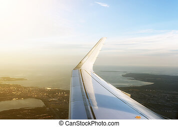 Aerial view of the plane wing over Tallinn city.