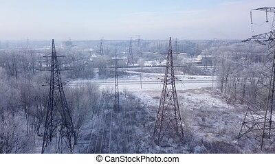 Aerial view of the power line near the railway in winter -...