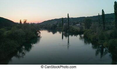 Aerial view of the river Cetina at dusk, Croatia - Stream of...