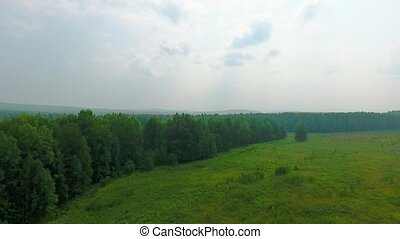 Aerial view of the road, forest and fields in the Sverdlovsk...