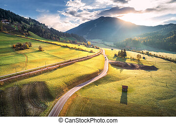 Aerial view of the road in mountain valley at sunrise