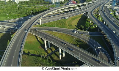 aerial view of the road junction in Moscow at sunny day,...