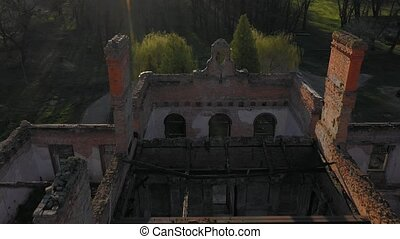 Aerial view of the ruins of Tartakivsky castle and the landscape around, Lviv region, Ukraine. Palace of Potocki, Lanzkronronski