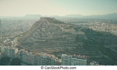 Aerial view of the Santa Barbara castle within Alicante cityscape