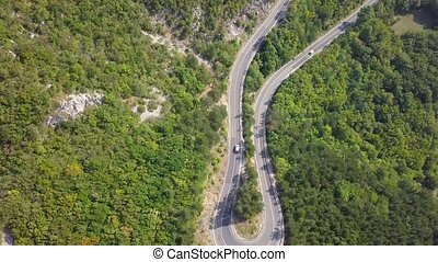 Aerial view of the serpentine mountain road. Croatia. Top view