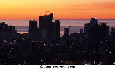 Aerial view of the Silhouettes of Skyscrapers against the...