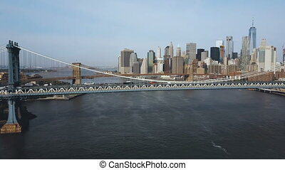 Aerial view of the skyscrapers in downtown in New York, America. Manhattan bridge going through the East river.