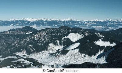 Aerial view of the snowy rocky High Tatras Mountains in clear weather. Slovakia, Chopok