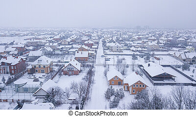 Aerial view of the snowy village in the afternoon