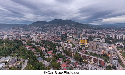 Aerial view of the southern part of Sarajevo city day to night timelapse.