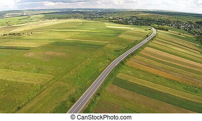 Aerial view of the sown fields near the motorway