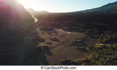 Aerial view of the Teide National Park at sunset, flight...