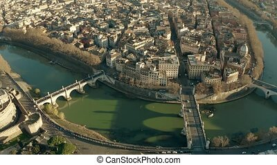 Aerial view of the Tiber river, bridges and embankments near...