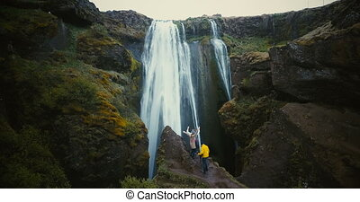 Aerial view of the tourist looking on Gljufrabui waterfall...