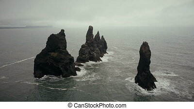 Aerial view of the troll toes mountains on the sea in...
