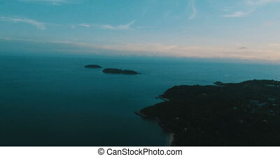 Aerial view of the tropical island, sea and sky