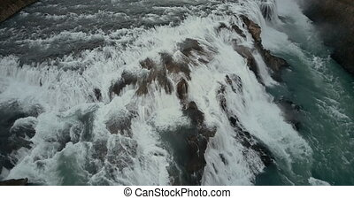 Aerial view of the turbulent flow of water in the cliffs....