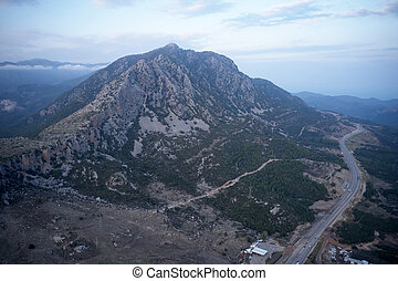 Aerial view of the valley with mountain in the background.