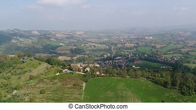 Aerial view of the vineyards of Italy, small medieval town of Italy, Panoramic view from above of the vineyards of Italy
