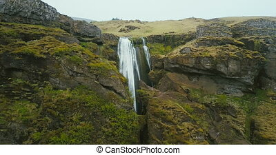 Aerial view of the waterfall Gljufrabui in mountain in...