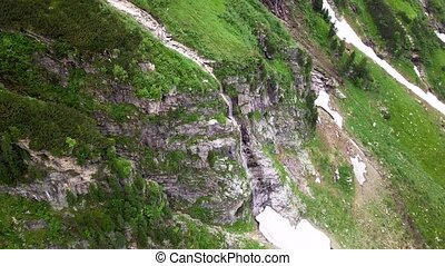Aerial view of the waterfall highly in the Alpine mountains. Austria