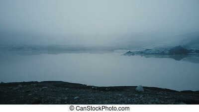 Aerial view of the white glacier Myrdalsjokull in the morning, in the fog, Iceland. Ice melting concept.